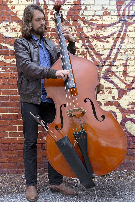 Seth Barden playing upright bass. Photo by Angelys Ocana.