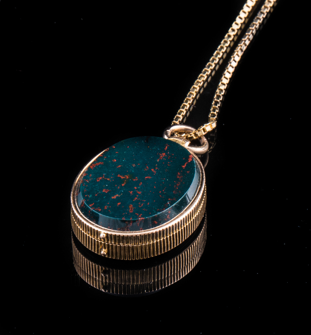 14Kt Cictorian reversible bloodstone and carnelian  locket with a gold chain