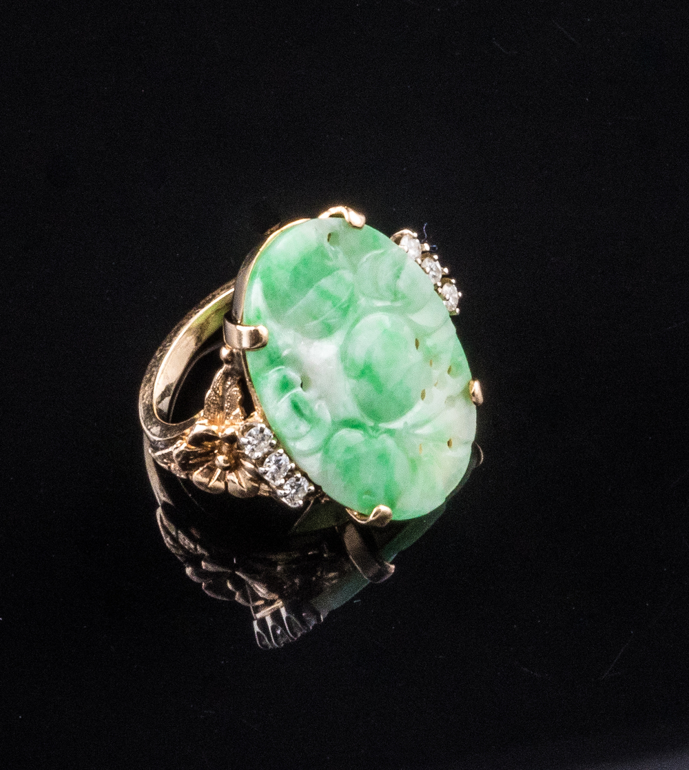 1950s carved jade ring accented with side diamonds