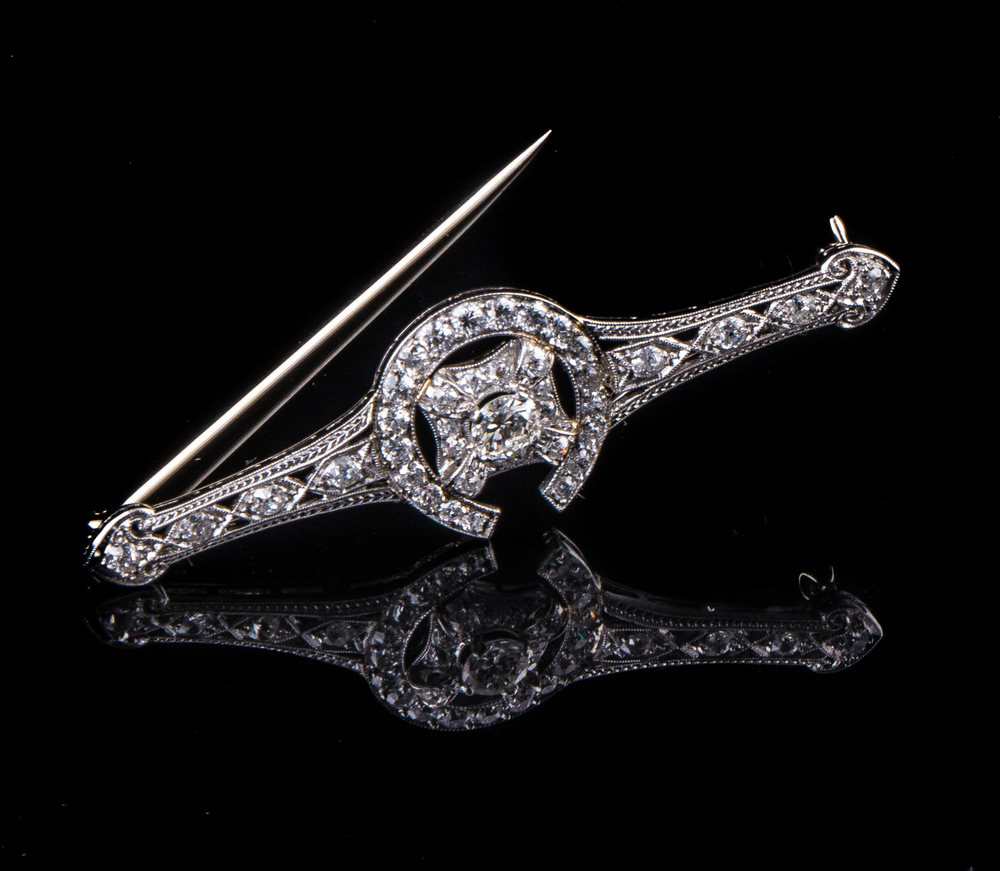 Art Deco horseshoe design platinum brooch with diamonds