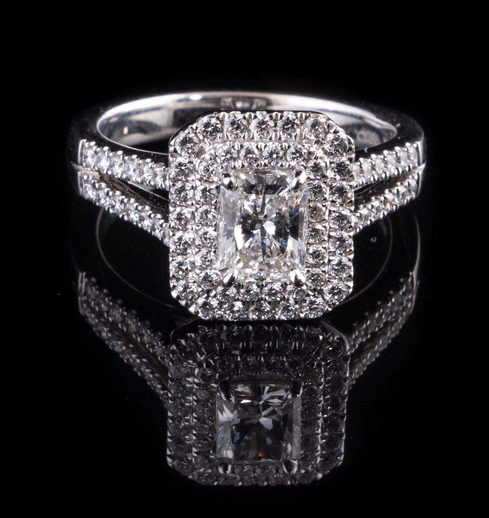 14kt white gold double halo ring with 072 carat center radiant cut Diamond and 075 carat accent Diamonds.jpg