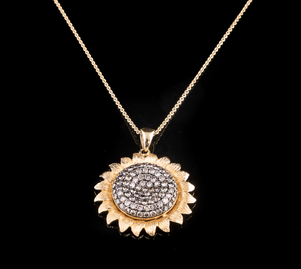 18kt yellow gold sunflower pendant with champagne Diamonds..jpg