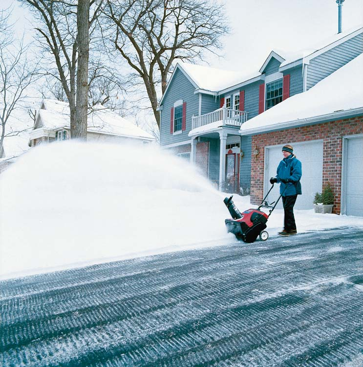 Single Stage Snow Blower in use lady.jpg