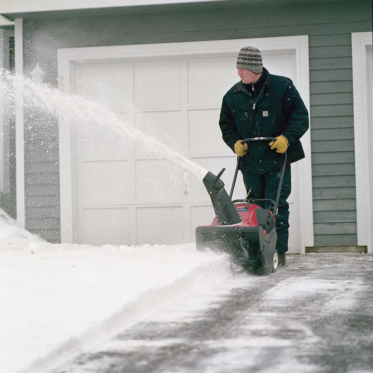 Single Stage snow blower in use clean driveway.jpg