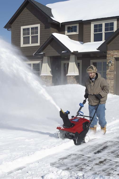 toro single stage snow blower in use  side photo.jpg