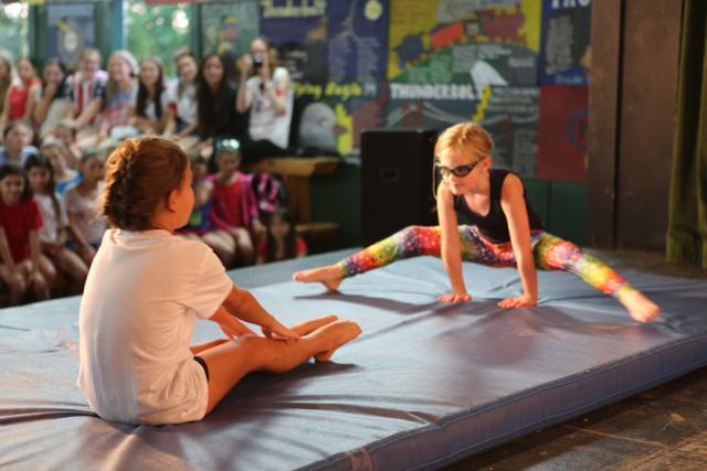 A Jinter and Inter perform gymnastics.
