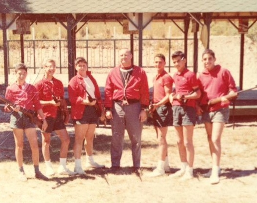 From  Steve Florin —1960s Riflery Team from the 1950s:  Paul Goodman, Scooter Schneider, Dennis Plehn, Coach Bill Powley, Steve, Drew Drazen  and  Frank Gunsberg  (love the red jackets).,