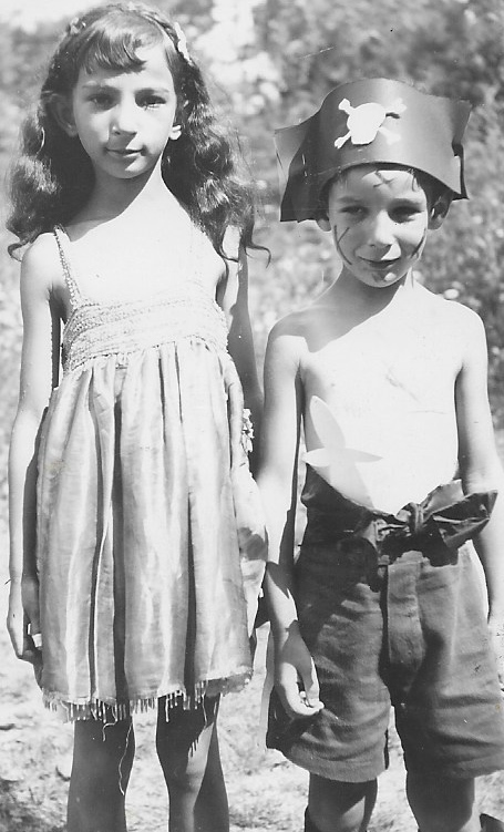 "1930s: Arline Morris Lubin and her brother Rem. Arline is dressed as a princess and Rem as a pirate for an ""Aquacade"""