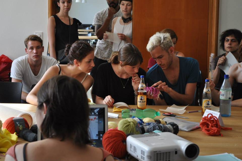 A Kommen & Bleiben workshop in knitting at Berlin's Weißensee art academy that welcomes students and refugees to teach and take part in courses like this. Source: K&B