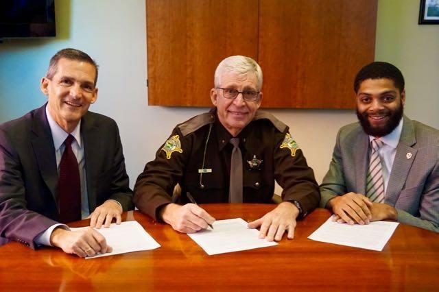 Photo Credit: City of Valparaiso Left to right: Mayor Jon Costas, Sheriff Dave Reynolds, Darryl Jackson Jr.