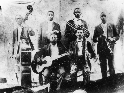 Pictured: Top: Jimmy Johnson (bass), Bolden (cornet), Willy Cornish (Valve Trombone), Willy Warner (Clarinet) Bottom: Brock Mumford (Guitar), Frank Lewis (Clarinet)