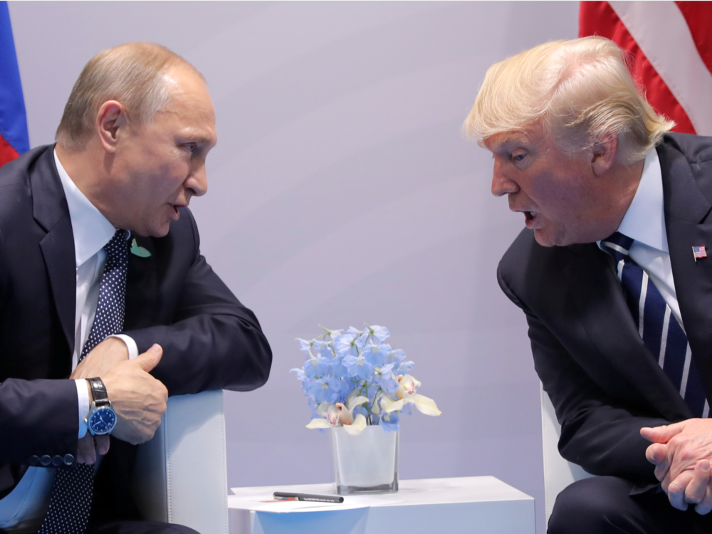 Vladimir Putin and Donald Trump at the G20 Summit. Credit:  Carlos Barria/Reuters