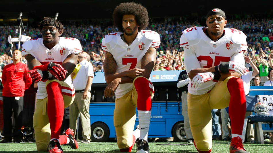 Kaepernick's former 49er teammates  Eli Harold, left, and Eric Reid, right Credit: TED S. WARREN/AP