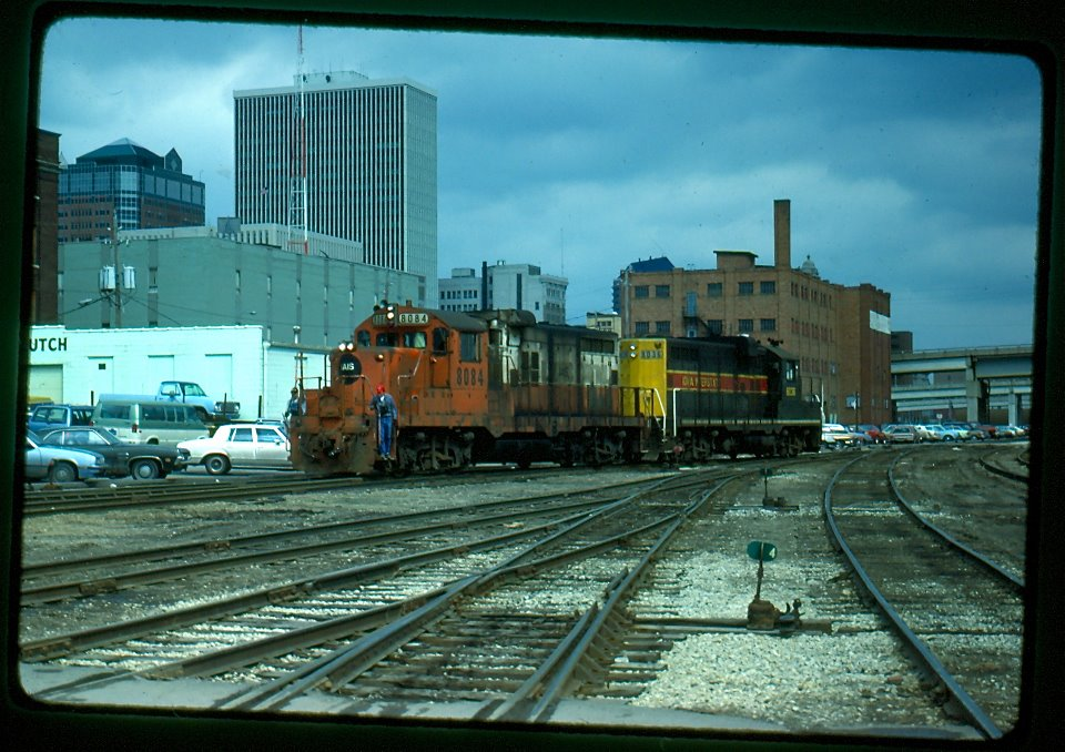Two different paint schemes, old and new, for the IAIS traveling over the Des Moines Union Railway yard tracks. This was taken at around 10th and Cherry. The white City Brake & Clutch building at left is currently The Gallery adult store. These tracks were torn up in 1996.