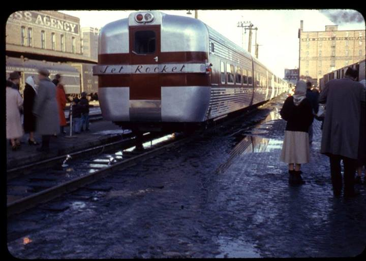 """Riders watch as the Rock Island """"Jet Rocket"""" passenger train pulls out of the station, headed east from Des Moines.Photo Circa 1955."""
