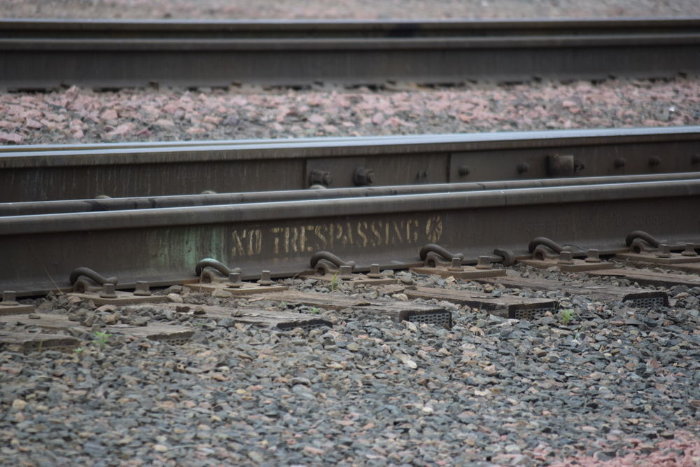 This piece of rail at the Shortline Yard says it all - hanging out in these yards can be dangerous.