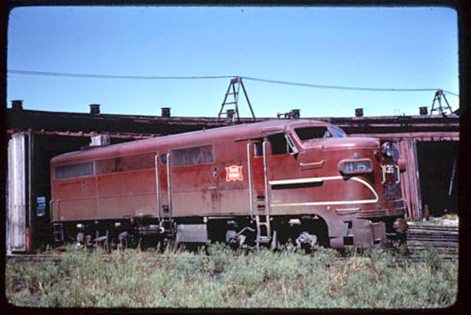CRI&P Engine 135 sitting derelict somewhere in Des Moines only years before the entire line collapses. Photo circa late 1970's.