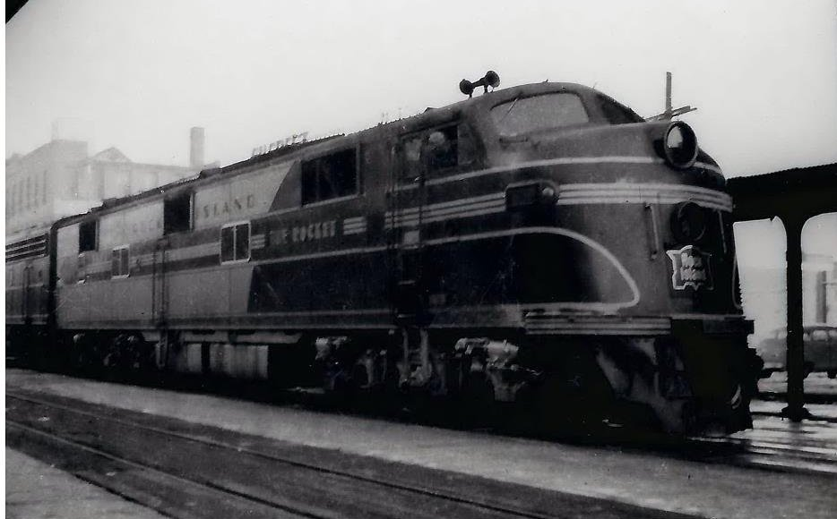 Rock Island Rocket engine 635, primarily hauling passenger cars from west into Chicago, with a number of stops throughout Iowa and Illinois. Photo circa 1960.