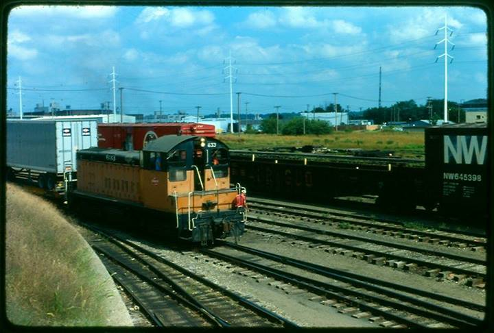 Milwaukee Road switch engine sits parked at the Des Moines Union Railway yard. View is southeast from approx location of current Nationwide parking ramp.Photo circa 1979.