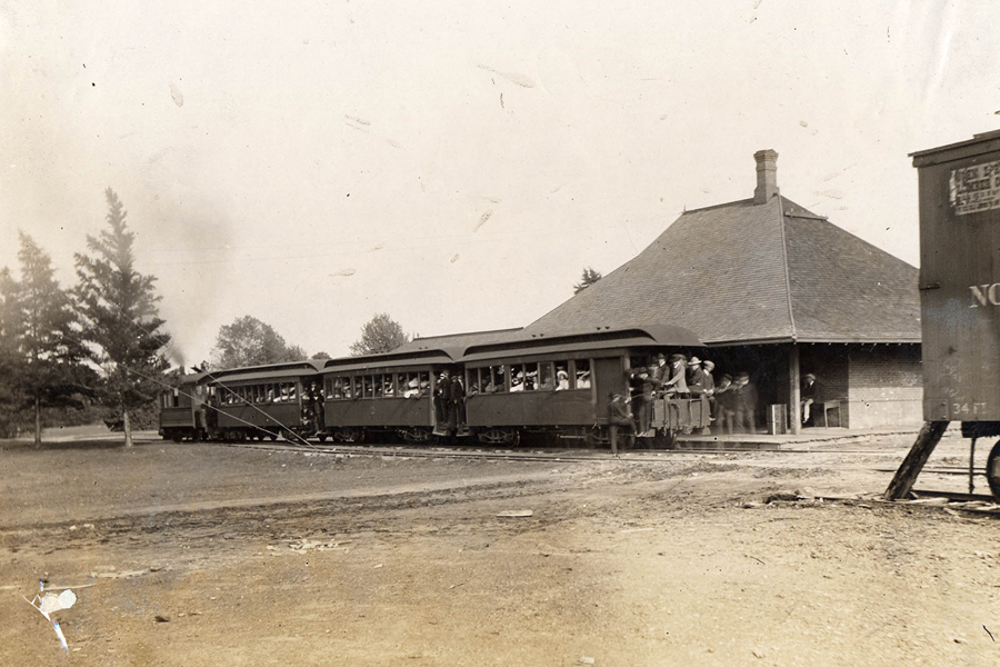 FDDM&S passenger train running steam engine shortly after purchase of Ames ( College Railway, photo taken at station across from current library, station is still standing. Photo circa 1906.