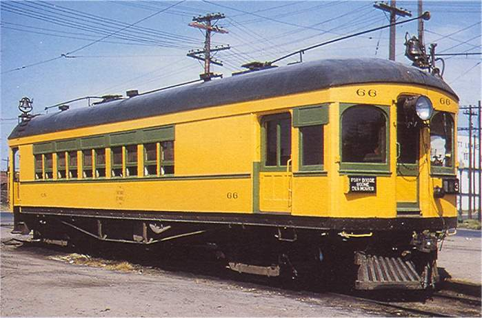 FDDM&S passenger car 66 headed throughDes Moines, Aug 30, 1953.