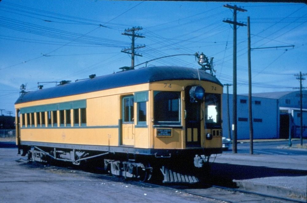 FDDM&S passenger car 74 travelling through Des Moines.Jewett Lumber in background, somewhere near 9th and Grand. Photo circa 1953.