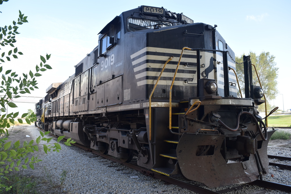 NS Engine 9019 parked under the Fleur Ave bridge on siding that was once owned by the DMUR as part of an extensive yard. IAIS purchased this and other tracks from the collapsed CRI&P as part of the IAIS mainline. Photo taken 09/04/15.