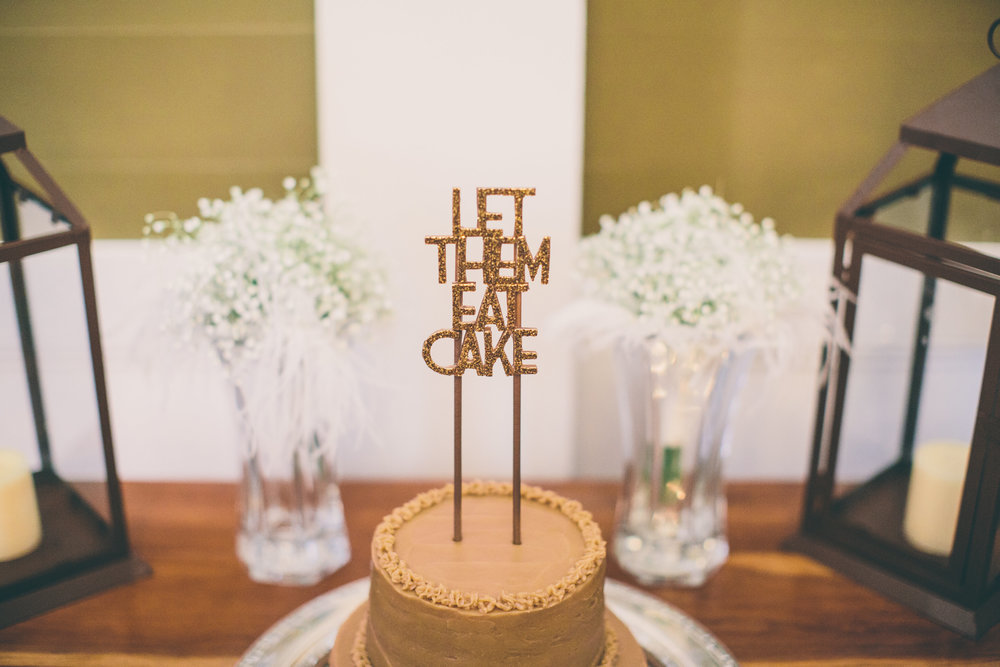 Caramel cake with custom cake topper.