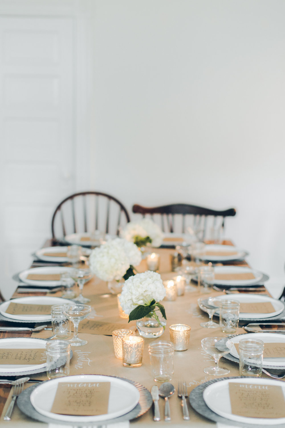 Beautiful tablescape with galvanized metal and white florals.