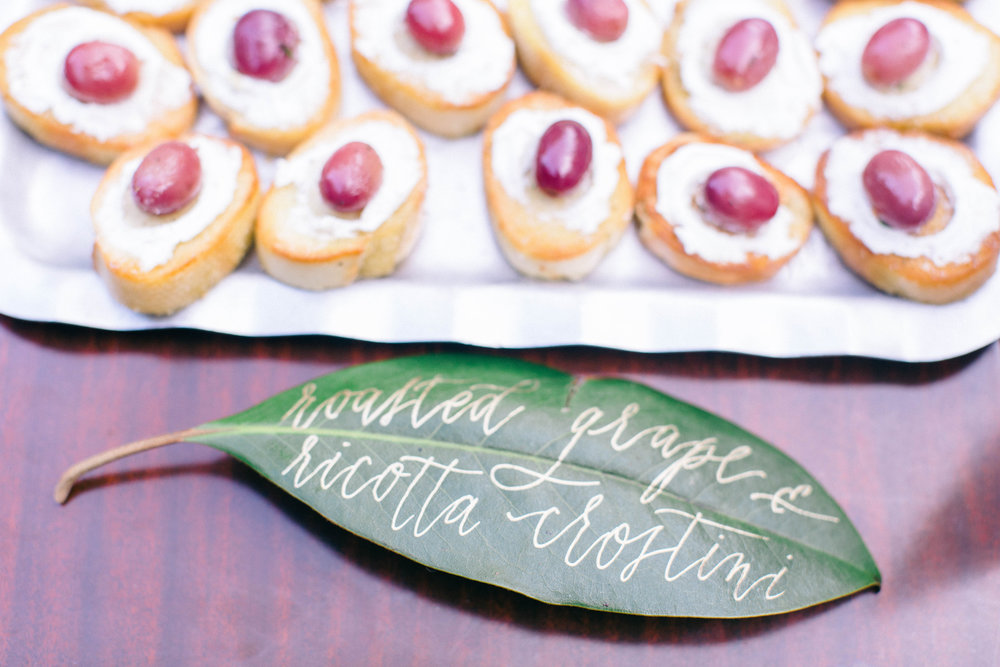 Food displays on magnolia leaves.