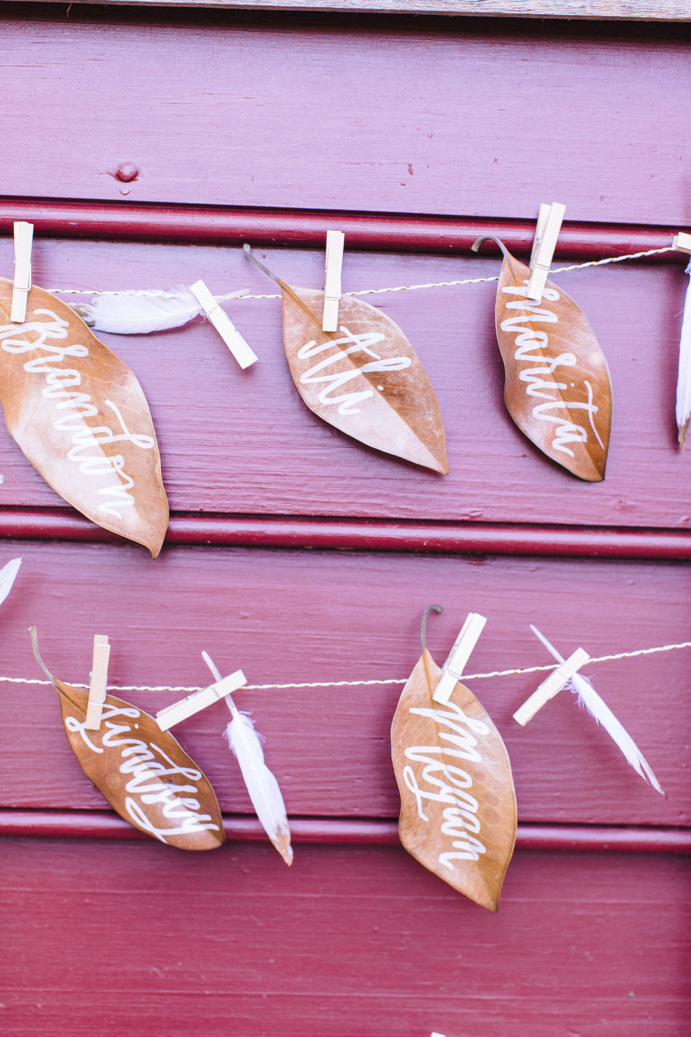 Guests names painted on magnolia leaves.