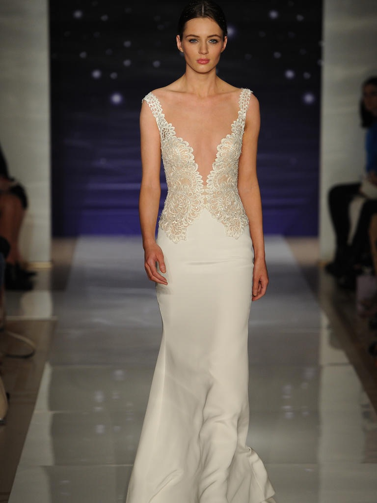 Reem Acra   shows off a plunging neckline from their collection