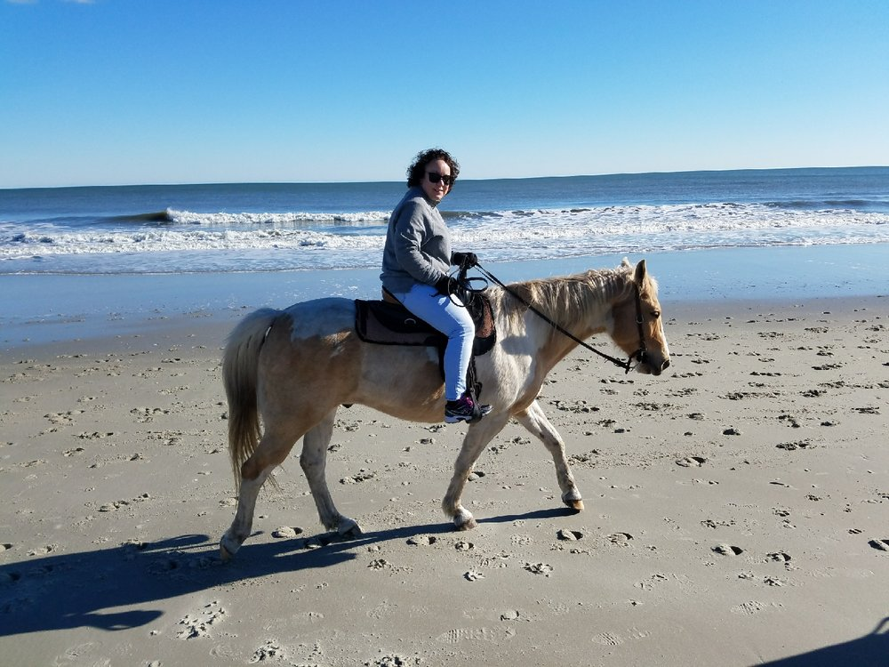 That's me taking a horseback ride on the beach thanks to my parents, a Christmas present to our family. One of the perks where I live now!