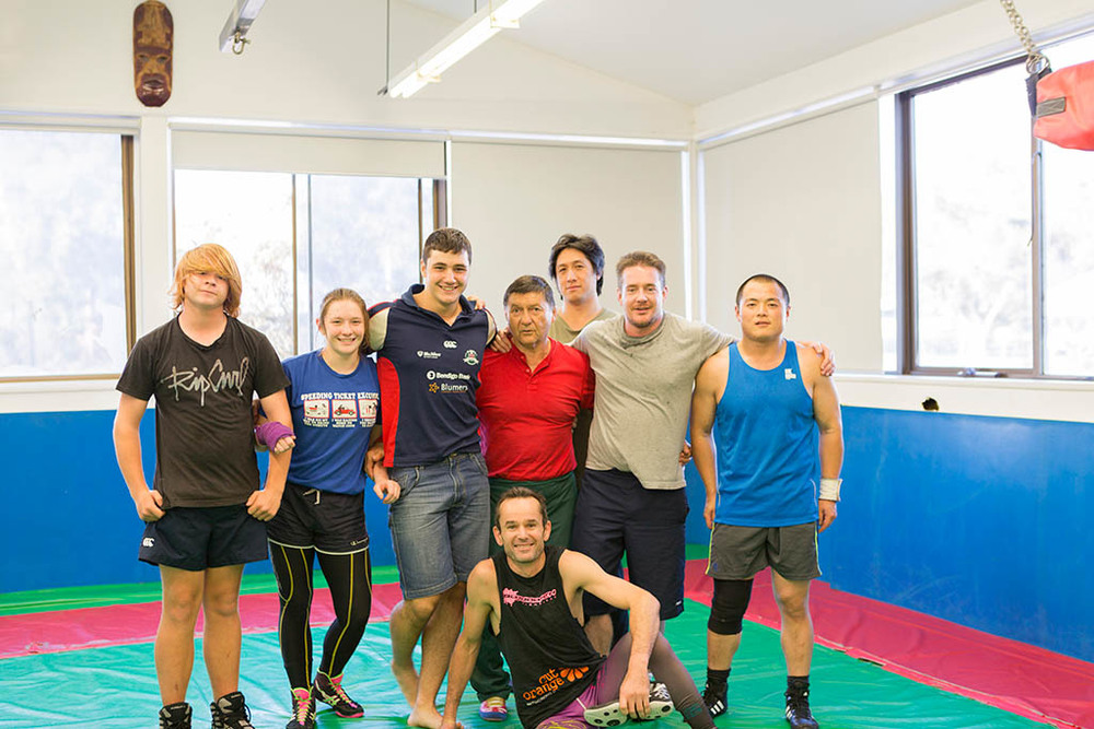 Wrestling at Canberra PCYC Erindale Centre, with trainers Witold Rejlich (centre) and Ben Keaney (below centre)