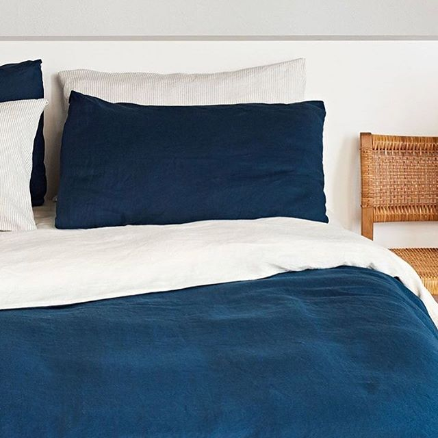 Navy & beige reversible duvet set paired with our striped sheets and pillow slips ||||