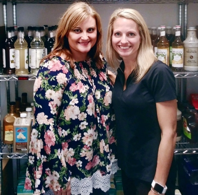 Janelle Reed, founder of SingleMomzRock, and Mary Rolf, owner of Scooter's Springfield.
