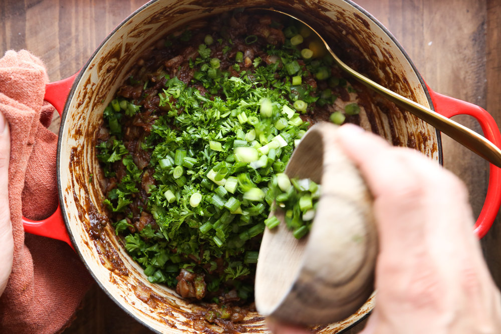 Adding in the green onion and parsley