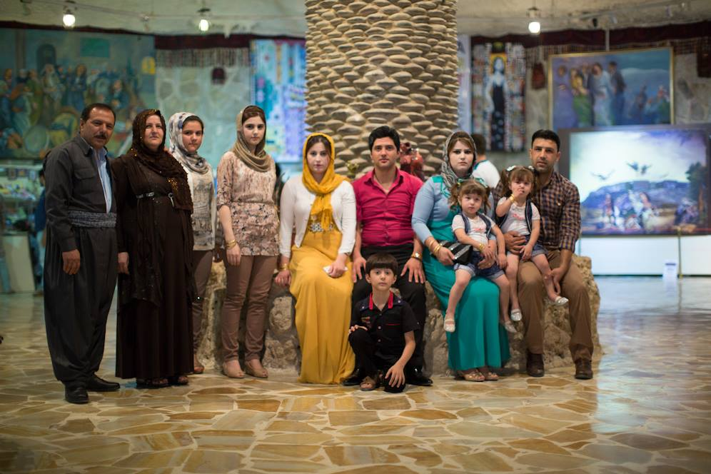 """We live in a very conservative culture, but I want my children to be open minded. I try to bring them to as many places as possible: big malls, art galleries, concerts. We want them to see as many types of people as possible, and as many types of ideas as possible."" (Erbil, Iraq)"