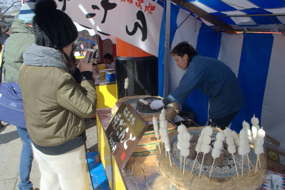 Outside the Fushimi Inari in Kyoto, you'd find food kiosks like these.