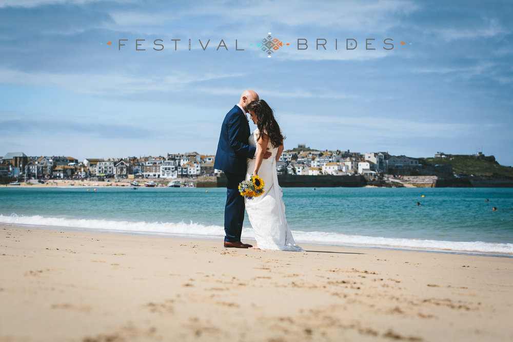 Dreaming of a day on the beach? The next closest thing is Hana & Phil's mid summer seaside wedding in St Ives featuring on   festivalbrides   Weddings very rarely go without a hitch of some sort and sadly this was the case for Hana and Phil. The day before their wedding, gale force winds struck their marquee leaving it damaged and not fit for purpose. With only 24 hours notice they had to move their whole reception into their ceremony venue, St Ives Guildhall. With the help of their friends and family all putting on hands they made this happen and it looked beautiful! The day of their wedding was blessed with beautiful sunshine for some great shots on the beautiful St  Ives beaches.. To read more about this fantastic day and get inspired follow the link above