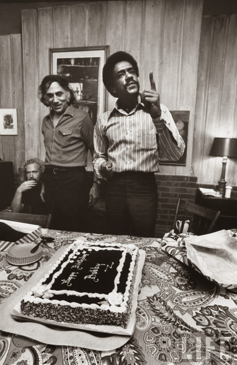 Black Panther Party co-founder Bobby Seale on the far right enjoying a cake in celebration of his birthday.