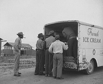 Laborers in an agricultural work camp in Bridgeton, New Jersey purchasing Ice cream from a truck that made daily visits, 1942. Courtesy of the Library of Congress