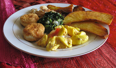Ackee and codfish served with callaloo, biscuits, and fried plantains (Asian plant)