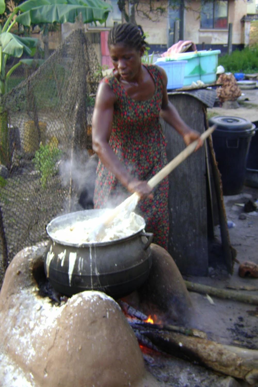 Cook in Ghana preparing rice -recipes below