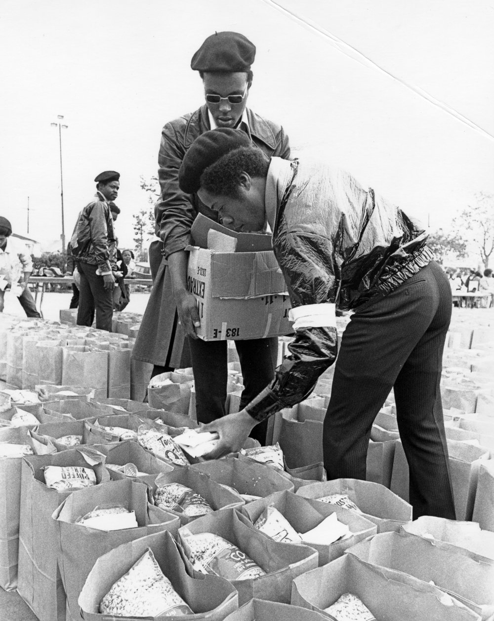 Members of the Black Panther Party for Self Defense stocking grocery bags for the party's food distribution program. Courtesy of Standford University Special Collection