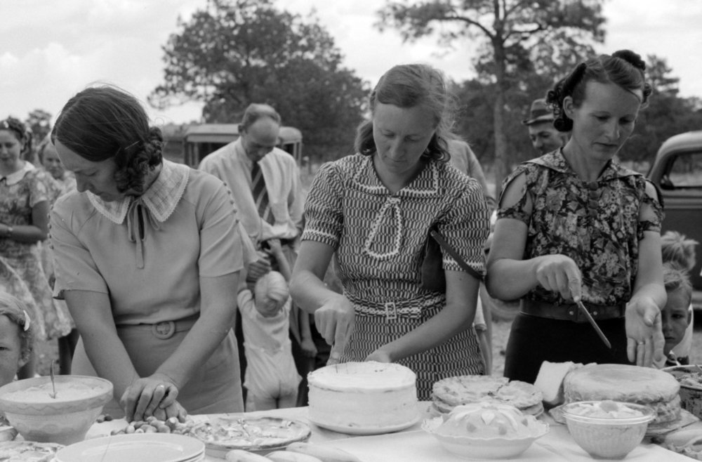 Cutting cakes at community event, Pie Town, New Mexico, 1940, Courtesy of the library of Congress