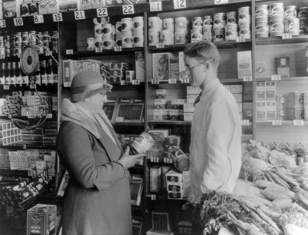 Customer and storekeeper in a grocery store, circa 1930, Courtesy of the Library of Congress