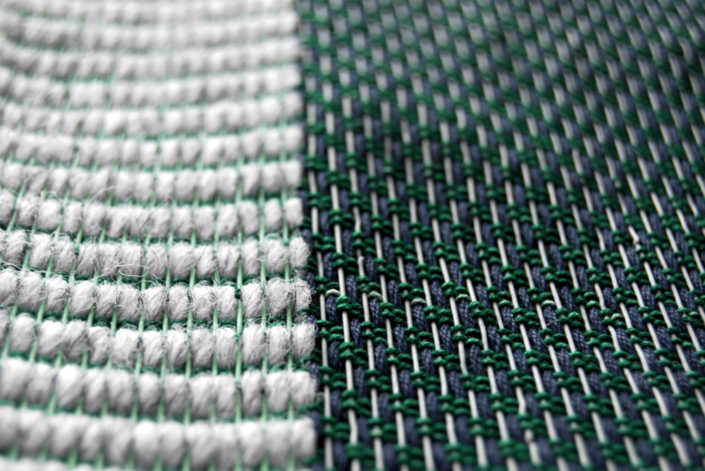 A hand woven fabric sample using reclaimed telecom cable.