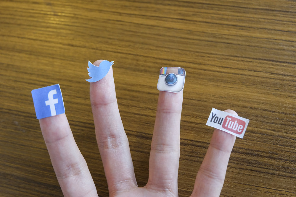 chiang-mai-thailand-september-24-2014-social-media-brands-printed-on-sticker-and-placed-on-human-finger-include-facebook-twitter-instagram-and-youtube_HvBYSguhGg.jpg