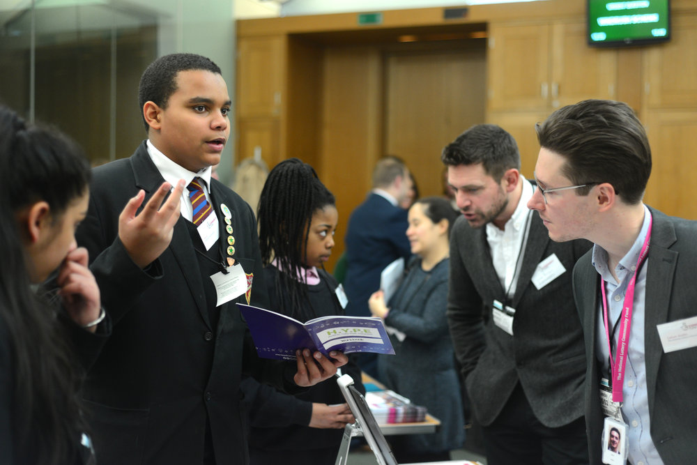 David, Anoopjit and Keisha speak to professionals at the event